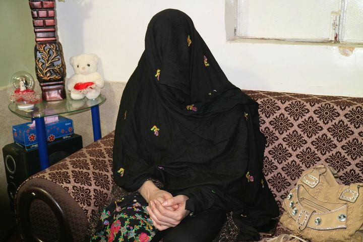 Gulalai, 25, a transgender Afghan living in Pakistan, covers her face to protect her identity.