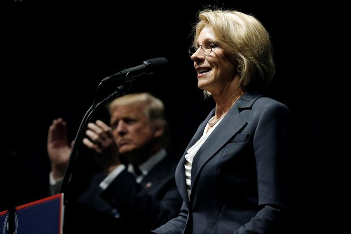 "Donald Trump applauds as Betsy DeVos, his pick for education secretary, speaks at a ""Thank You USA"" rally in Grand Rapids, Mi"