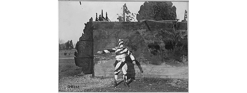 A soldier in World War I models early camouflage, 1917.