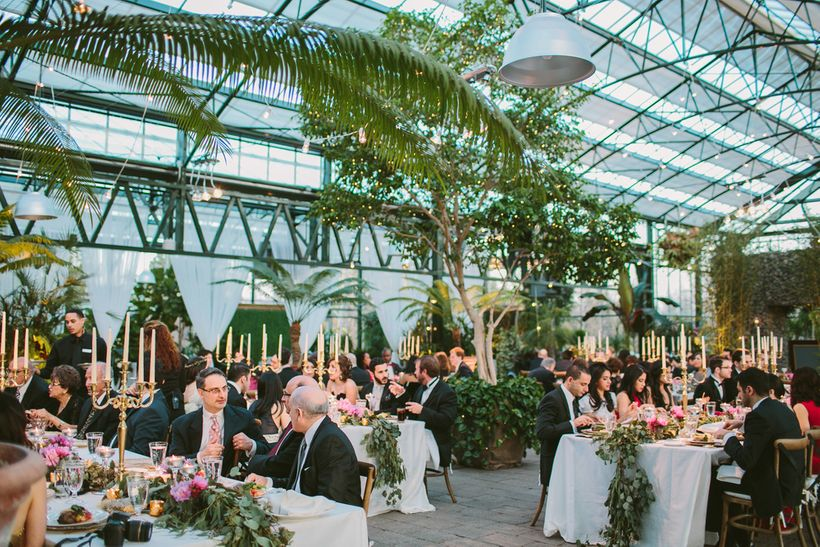 A wedding in the Planterra Conservatory, West Bloomfield, Michigan. Photo Credit: Jill DeVries Photography.