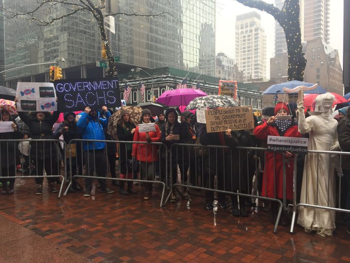 Hundreds of protesters endured the harsh weather conditions to speak out against Trump's proposed cabinet.