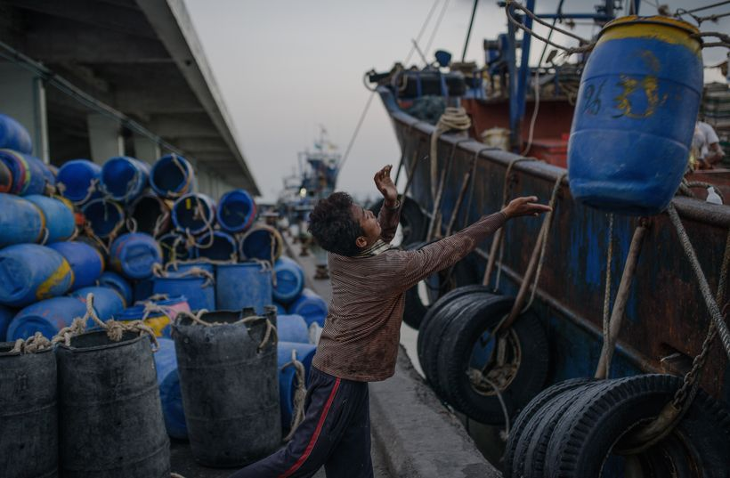 Young Cambodian migrant worker in Thailand's fishing industry.
