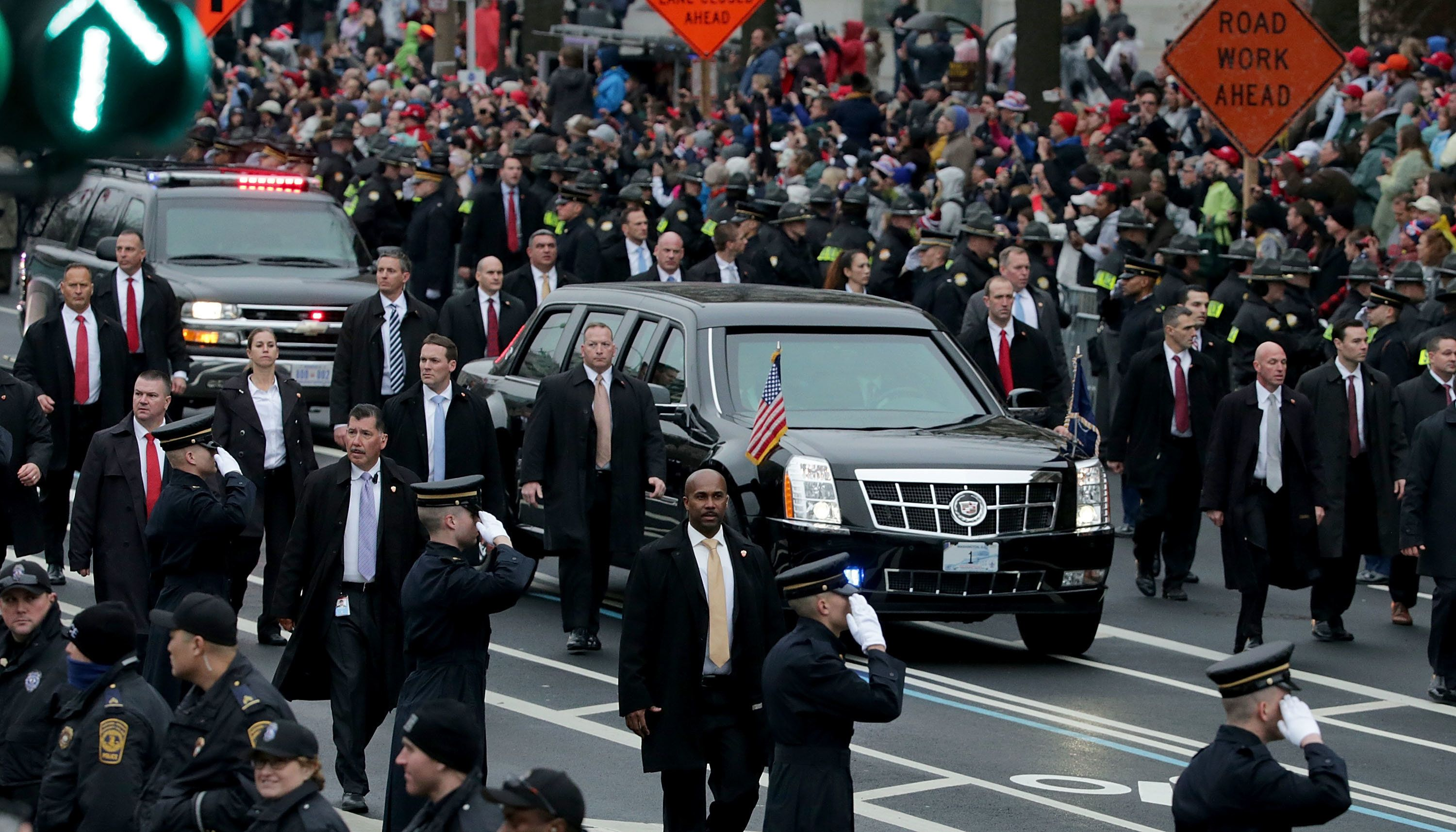 WASHINGTON, DC - JANUARY 20:  Spectators line the sides of Pennsylvania Avenue as U.S. Secret Service agents walk alongside the presidential limousine  during the Inaugural Parade for U.S. President Donald J. Trump January 20, 2017 in Washington, DC. Trump was sworn in today as the 45th president of the United States.  (Photo by Chip Somodevilla/Getty Images)