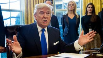 US President Donald Trump speaks before signing an executive order in the Oval Office at the White House in Washington, DC, on January 24, 2017. US President Donald Trump signed executive orders January 24, 2017 reviving the construction of two controversial oil pipelines, but said the projects would be subject to renegotiation. Trump gave an amber light to the Keystone XL pipeline -- which would carry crude from Canada to US refineries on the Gulf Coast -- and an equally controversial pipeline crossing in North Dakota.  / AFP / NICHOLAS KAMM        (Photo credit should read NICHOLAS KAMM/AFP/Getty Images)