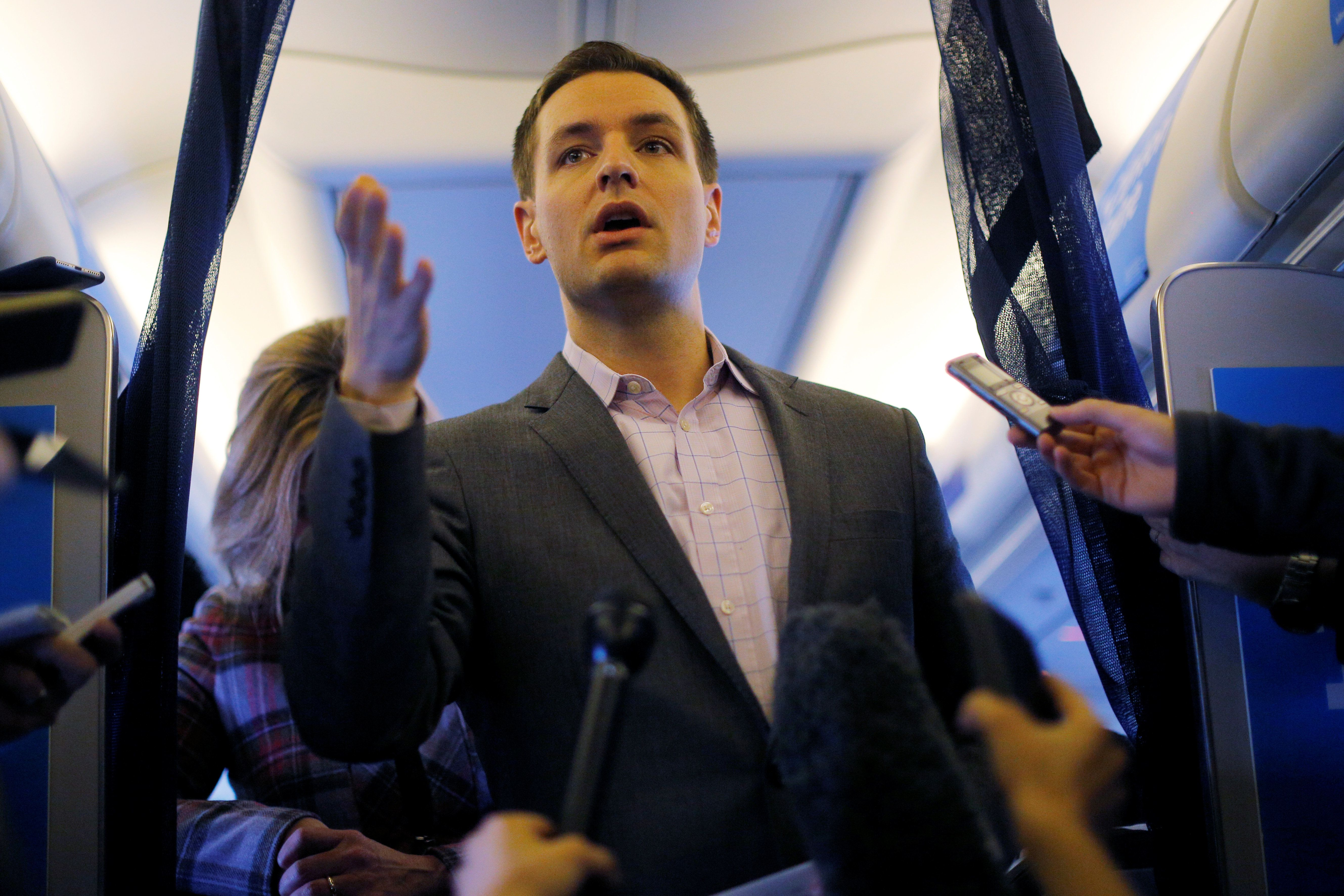 Robby Mook, Campaign Manager for U.S. Democratic presidential nominee Hillary Clinton, talks to reporters onboard the campaign plane enroute to Cedar Rapids, Iowa, U.S. October 28, 2016.  REUTERS/Brian Snyder