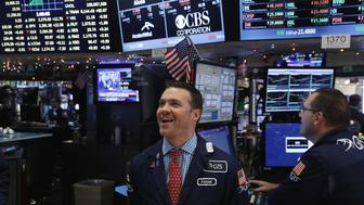 Traders laugh as they work on the floor of the New York Stock Exchange (NYSE) and react to the Dow Jones Industrial Average almost hitting 20,000 in New York, U.S., January 6, 2017. REUTERS/Lucas Jackson