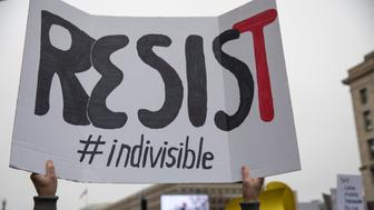 WASHINGTON, DC - JANUARY 21: A marcher attending the Women's March on Washington holds up a sign encouraging resistance on January 21, 2017 in Washington, DC. (Photo by Robert Nickelsberg/Getty Images)
