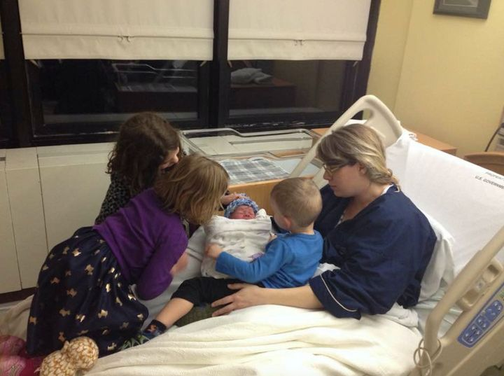 Annabelle (6), Penelope (5) and Isaiah (2) meeting Nate in the hospital.