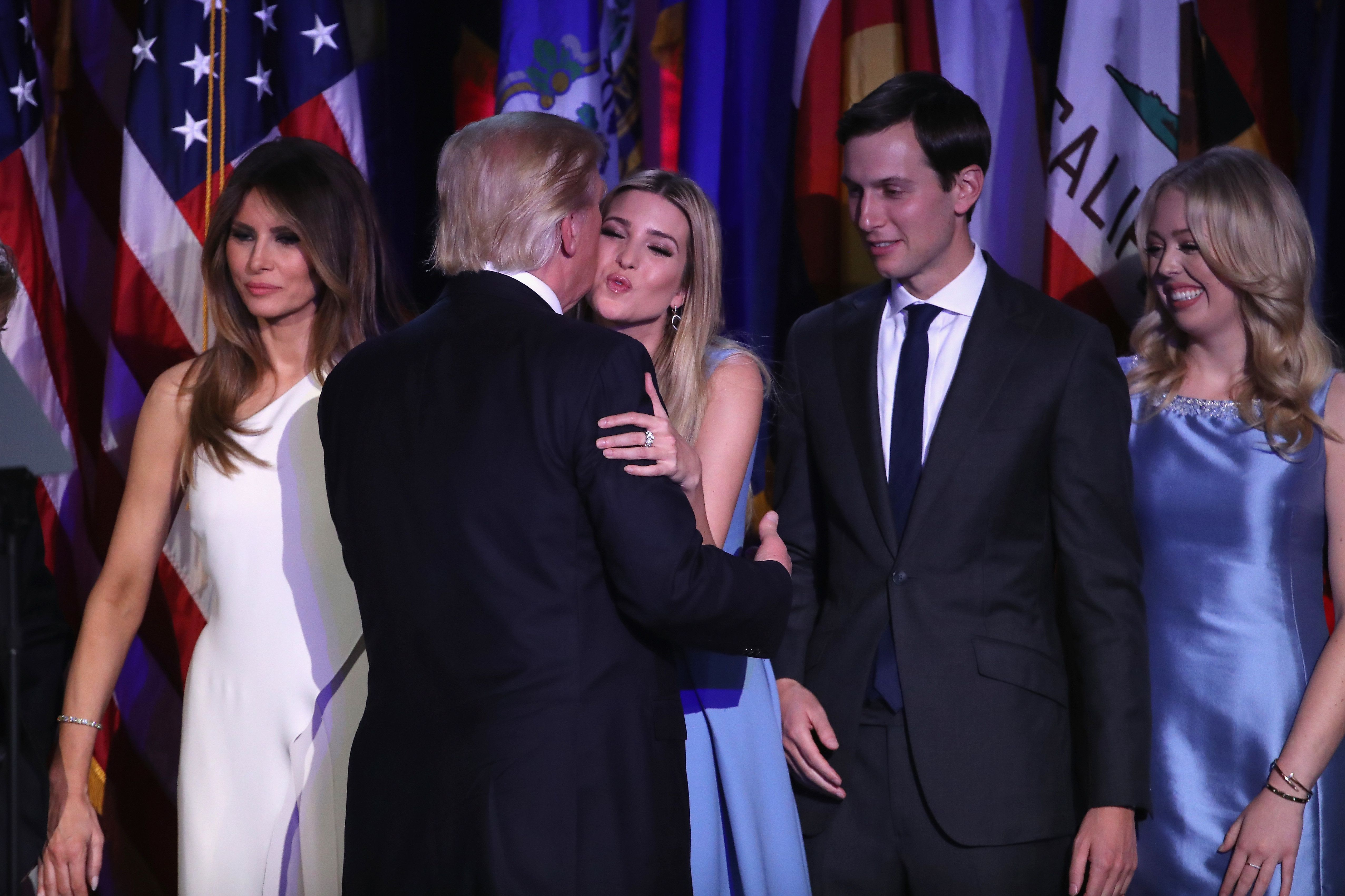 NEW YORK, NY - NOVEMBER 09:  Republican president-elect Donald Trump and his daughter Ivanka Trump embrace as his wife Melania Trump (L), Jared Kushner (2nd-R) ad Tiffany Trump look on after delivering his acceptance speech at the New York Hilton Midtown in the early morning hours of November 9, 2016 in New York City. Donald Trump defeated Democratic presidential nominee Hillary Clinton to become the 45th president of the United States.  (Photo by Mark Wilson/Getty Images)