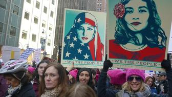 NEW YORK, USA - JANUARY 21: Protesters attend the Women's March to protest President Donald Trump in New York, USA on January 21, 2017. Thousands of protesters demonstrated across the US against the US President Donald Trump after Trump was sworn in as the 45th U.S. president. (Photo by Selcuk Acar/Anadolu Agency/Getty Images)