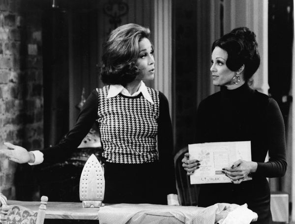 Mary Tyler Moore (L) speaks to Valerie Harper behind an ironing board in a still from the TV series, 'The Mary Tyler Moore Sh