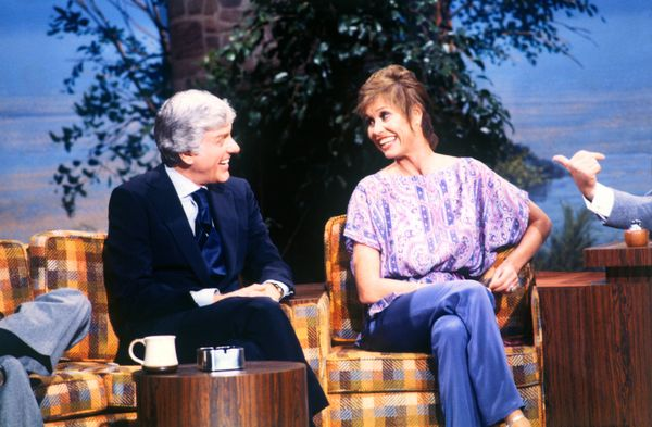 Dick Van Dyke cracks up on Mary Tyler Moore's shoulder as the two appear together for the first time on national television s