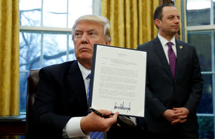 President Donald Trump holds up the executive order on the reinstatement of the Mexico City policy, Jan. 23, 2017. If history is any indication, it will result in even more abortions and maternal deaths worldwide.