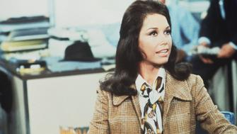 American actress and commediene Mary Tyler Moore (as Mary Richards) sits at a desk in a scene from 'The Mary Tyler Moore Show' (also known as 'Mary Tyler Moore'), Los Angeles, California, 1970. (Photo by CBS Photo Archive/Getty Images)
