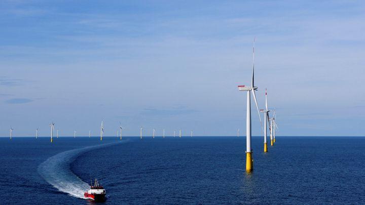 A boat sails past DanTysk wind farm in Esbjerg, Denmark.