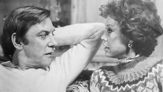 (Original Caption) Donald Sutherland and Mary Tyler Moore are shown in a scene from their movie, Ordinary People directed by Robert Redford and released by Paramount Pictures. They are shown conversing closely to each other. Sutherland and Moore attempt to pick up the pieces of their shattered life after a major tragedy by planning a holiday trip to London in this Paramount Picture's release, a Wildwood Enterprises Production.
