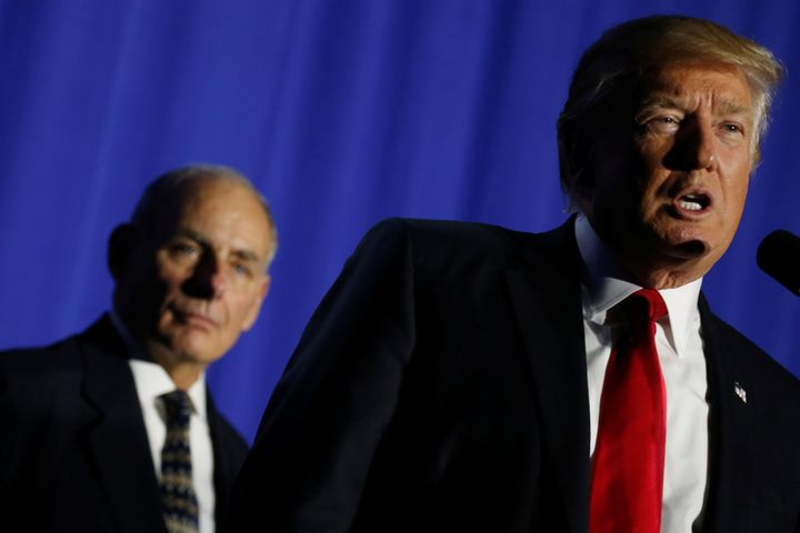 U.S. President Donald Trump (R), flanked by Homeland Security Secretary John Kelly (L), delivers remarks at Homeland Security