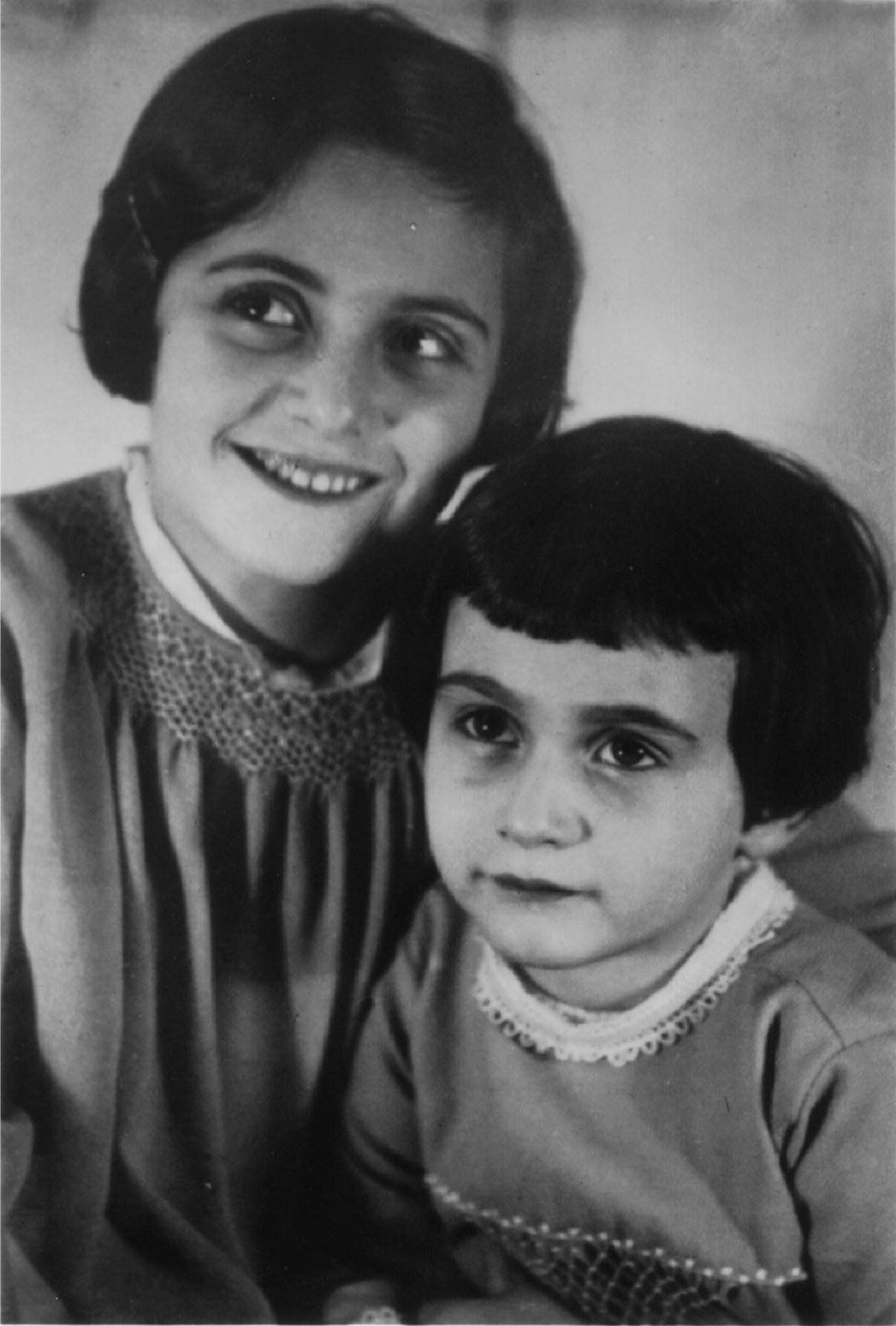 An undated family photo of Anne Frank as a young child with her older sister.