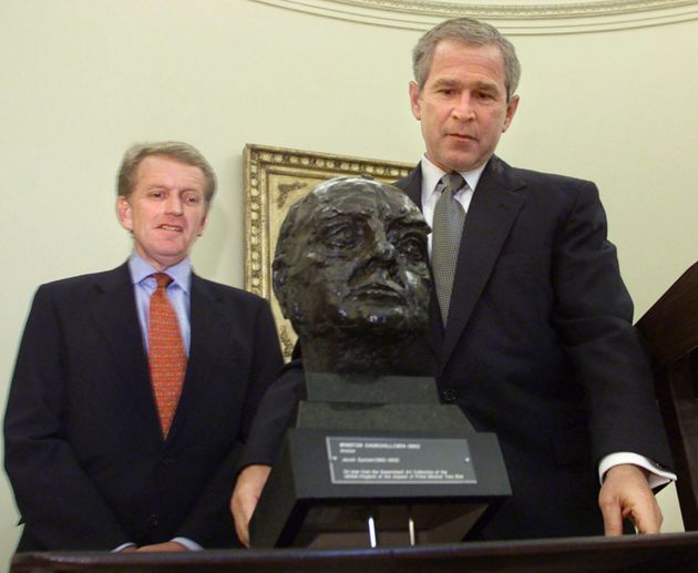 George W Bush inspects the Churchill bust in