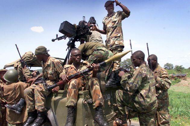 Sierra Leonean Army soldiers gather after having retaken the town of Masiaka from the Revolutionary United...