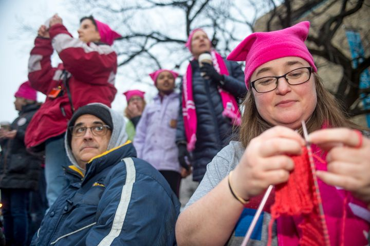 Emily Crowley from Vermont knits a pink hat for protesters at the Women's March on Washington.