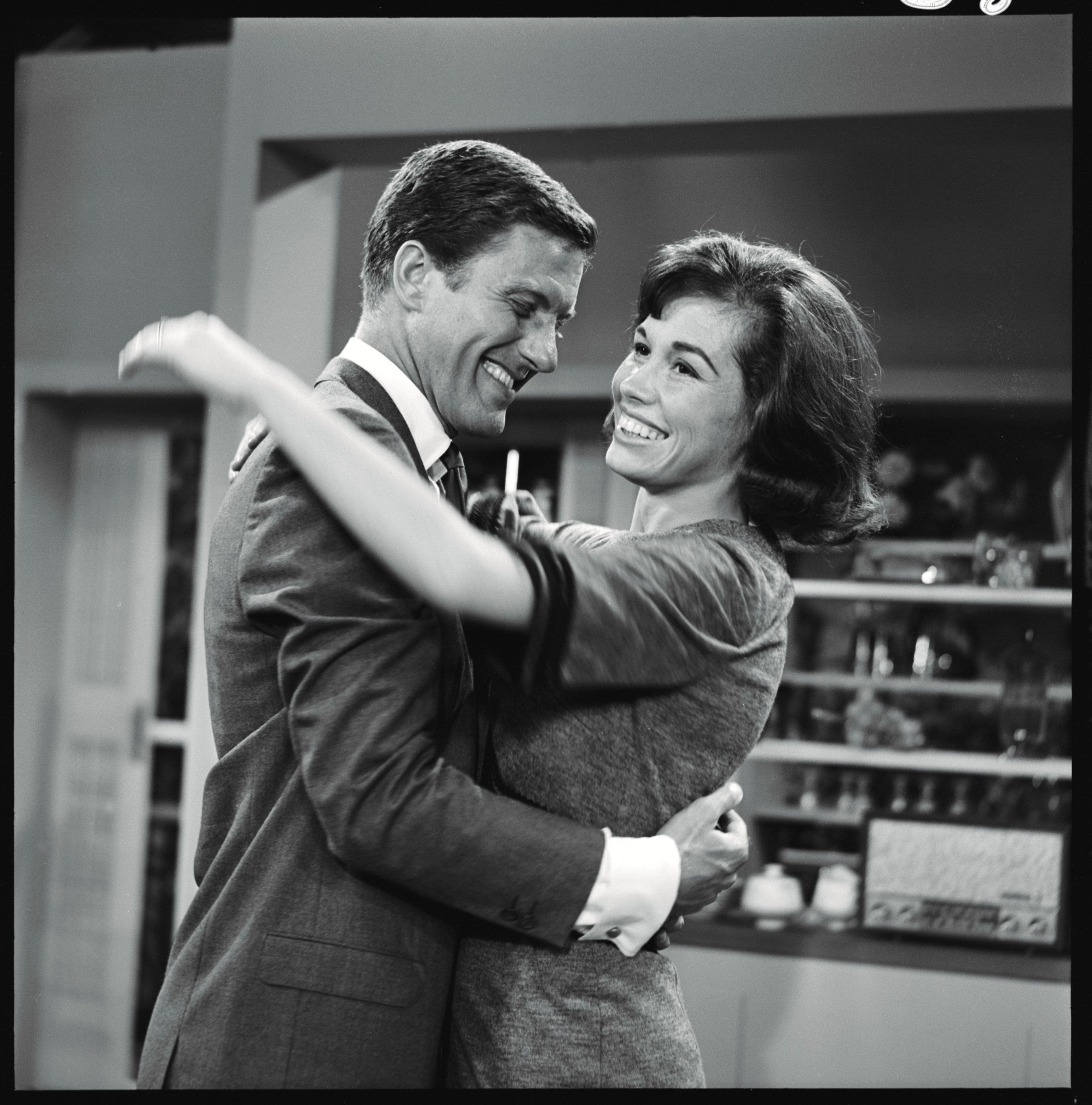 LOS ANGELES - JULY 10: THE DICK VAN DYKE SHOW with cast members Dick Van Dyke as Rob Petrie and Mary Tyler Moore as Laura Petrie on the set of episode 'Washington vs. The Bunny'. Image dated July 10, 1961. (Photo by CBS via Getty Images)