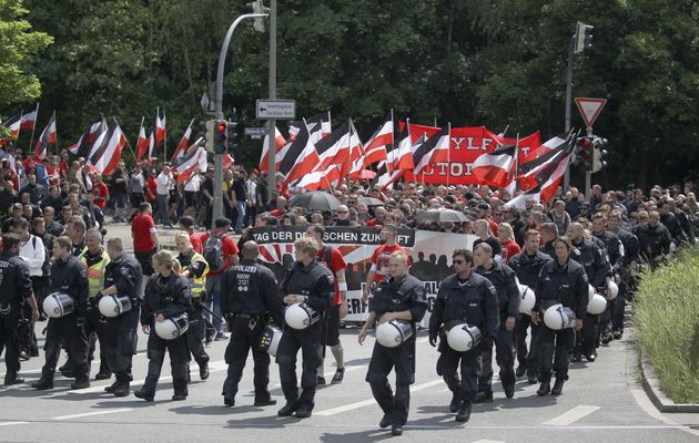 Neo-Nazi demonstrators march through the streets of Dortmund,