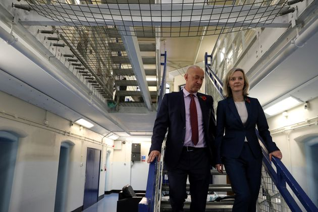 Justice Secretary Liz Truss, pictured above at HMP Brixton with Prison Governor David Bamford, hascautioned...