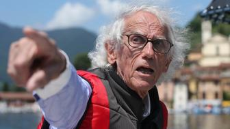 Bulgarian-born artist Christo Vladimirov Yavachev known as Christo gestures during an interview with the Associated Press on his installation 'The Floating Piers' on the Lake Iseo, northern Italy, Tuesday, June 7, 2016. Some 200,000 floating cubes create a 3-kilometers runway to be clad in bright yellow fabric and connecting the town of Sulzano to the small island of Monte Isola on the Iseo Lake for a 16-day outdoor installation opening on June 18 through July 3. (AP Photo/Luca Bruno)