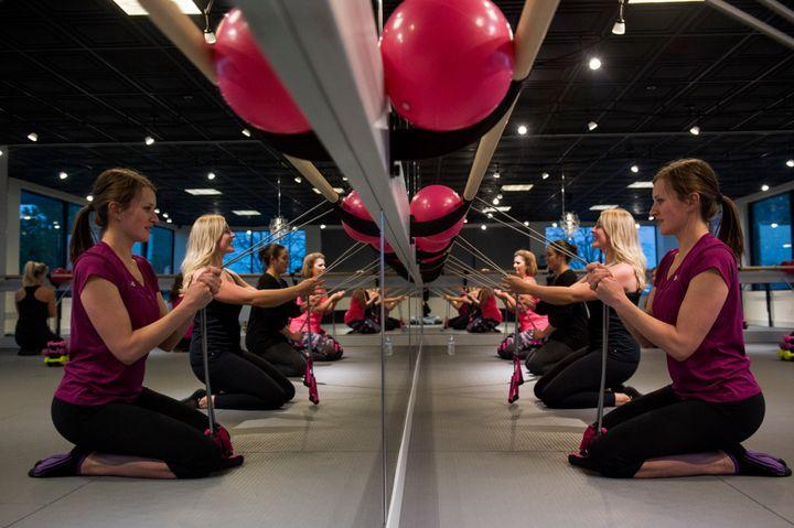 Women practice barre at a studio in Arvada, Colorado.
