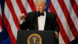 "U.S. President Donald Trump speaks on a live television link with U.S. troops overseas at the ""Salute to Our Armed Forces"" inaugural ball during inauguration festivities in Washington, U.S.,January 20, 2017.   REUTERS/Rick Wilking"