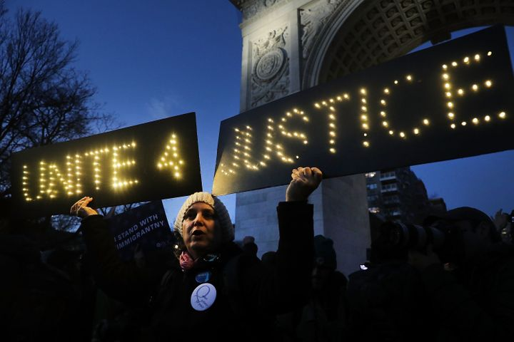 Hundreds of people attend a Wednesday evening rally at Washington Square Park in New York City in support of Muslims and immi