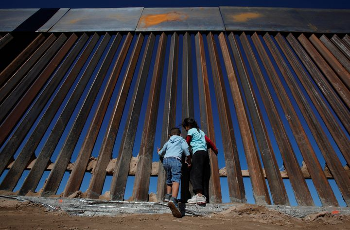 Children play at a newly built section of the U.S.-Mexico border wall at Sunland Park, U.S. opposite the Mexican border city