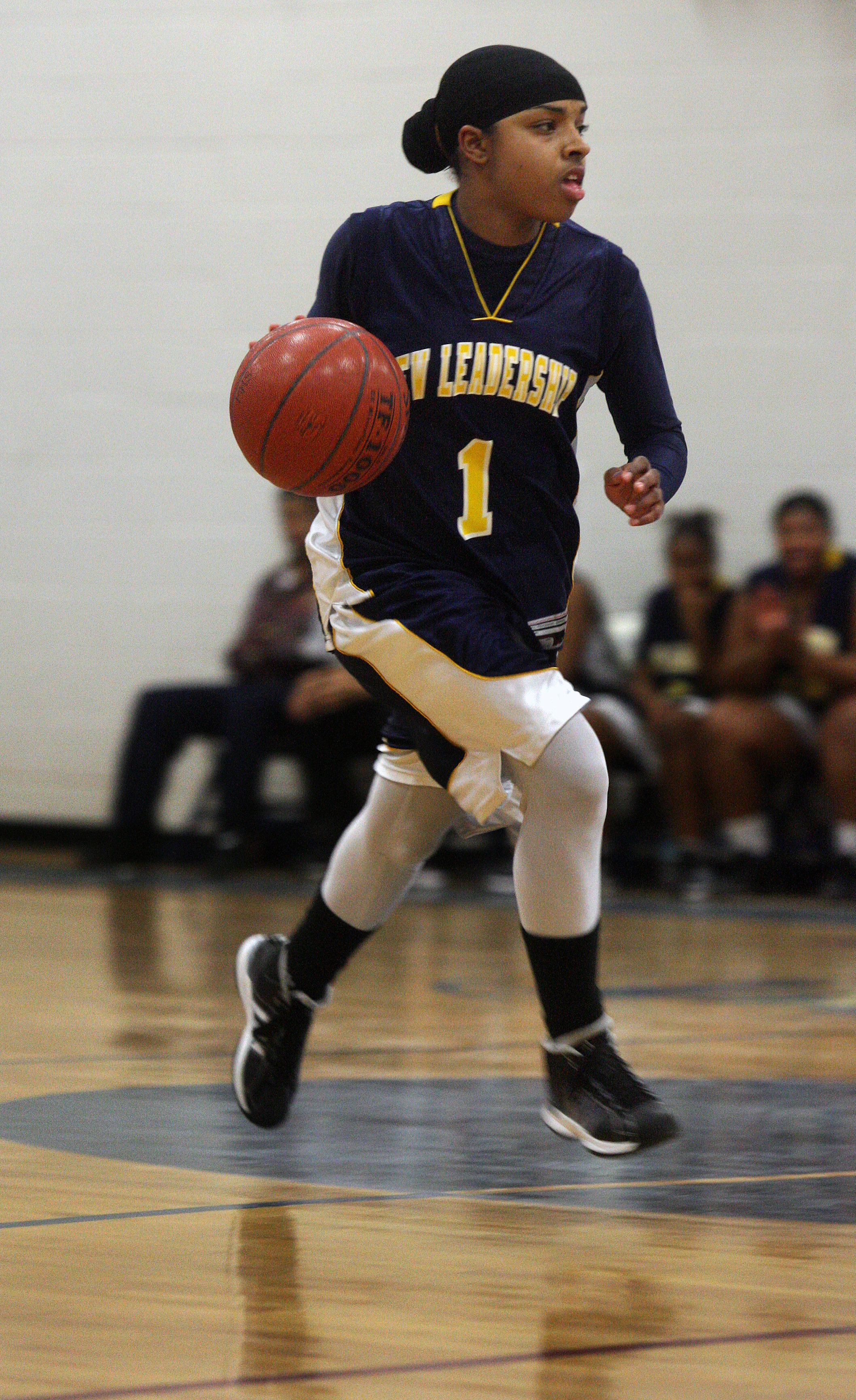 Bilqis Abdul-Qaadir wears a hijab and long sleeves and covers her legs under her uniform when she plays basketball.