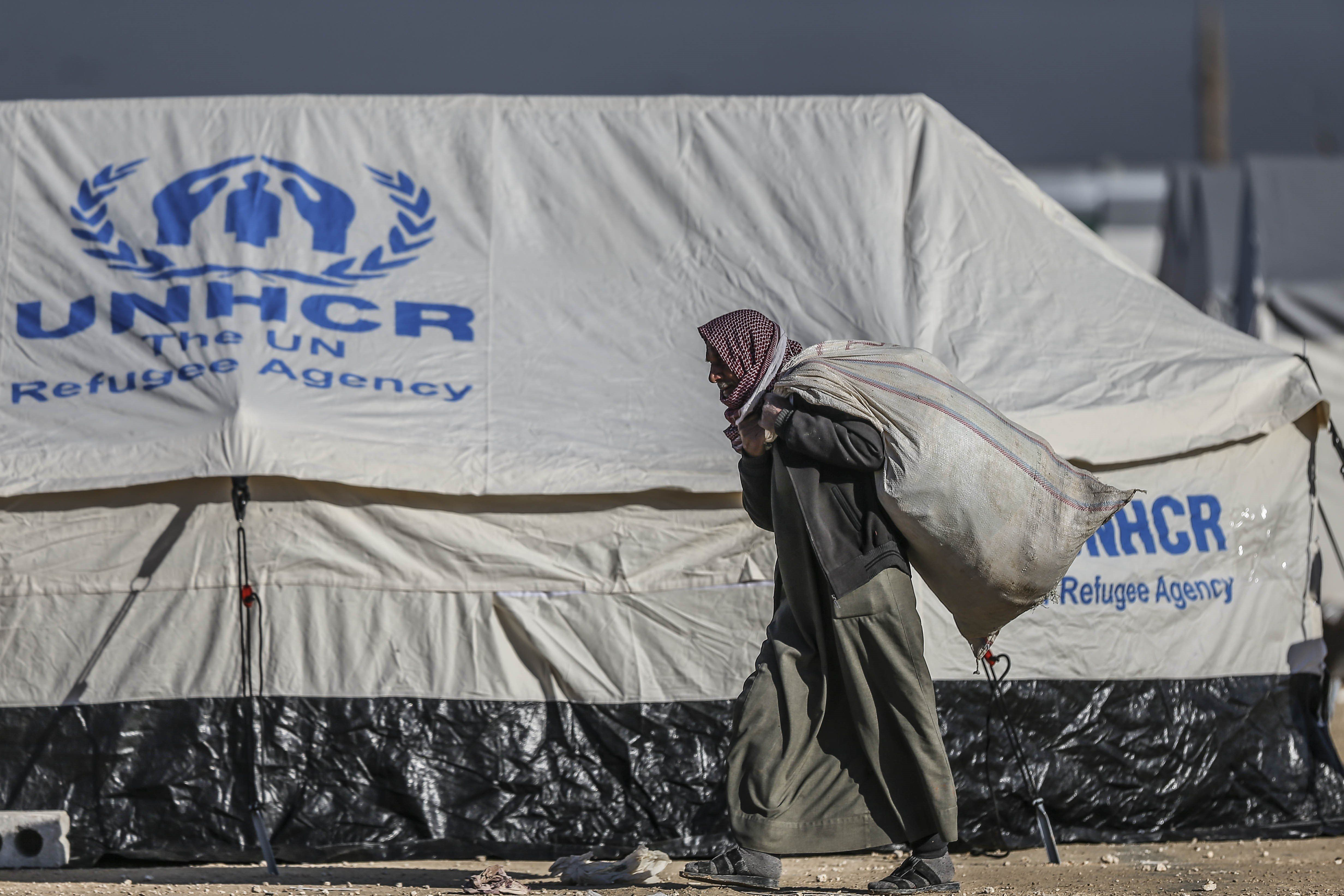 ALEPPO, SYRIA - FEBRUARY 10: Syrians who flee the attacks of Syrian and Russian air forces, shelter at tents and try to live their lives with humanitarian aid send by Turkey, UNHCR and other Turkish Humanitarian aid organizations, close to the Bab al-Salameh border crossing on Turkish-Syrian border near Azaz town of Aleppo, Syria on February 10, 2016. (Photo by Fatih Aktas/Anadolu Agency/Getty Images)