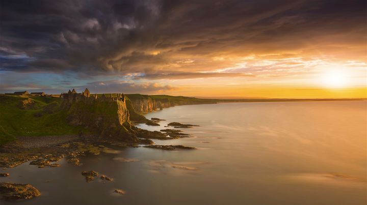 "Location:&nbsp;Dunluce Castle, Co. Antrim, Northern Ireland.&nbsp;<br /><br />""Very impressive place. One of my favorite places in Northern Ireland. This evening was an unreal sight.""&nbsp;"