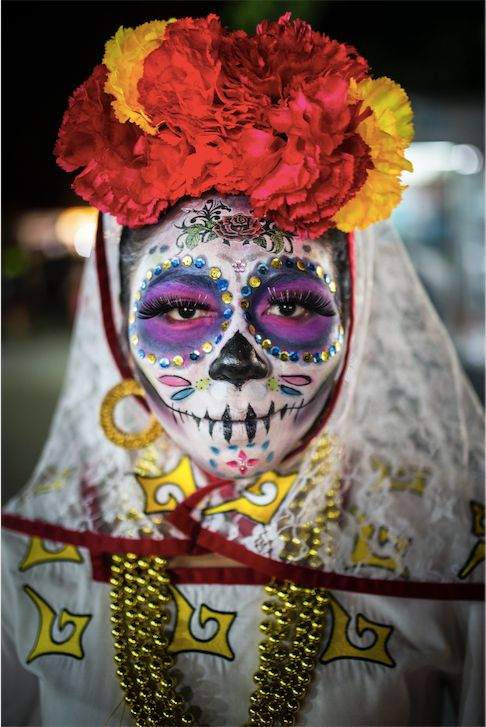 "Location: Parque de las Palapas, Cancun, Mexico. <br /><br />""The portrait of a woman dressed in skull-candy face paint and costume to celebrate the Day of the Dead festival in Cancun's El Parque De Las Palapas, Mexico.  The festival, locally known as 'Dia De Los Muertos' is an annual celebration in memory of loved ones who have passed away."""