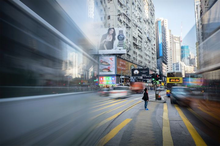 "Location:&nbsp;Sogo, Hong Kong<br /><br />""I took this image while travelling to Hong Kong on a video commission for my company, Heehaw. We had been directed to the crossing at Sogo; a great location to capture hoards of people moving between breaks in the traffic. Shooting there for a while, I saw this one man make a break for it but only get as far as the central island before the traffic started again. For a few minutes we were completely isolated in an otherwise overcrowded and frantic urban environment, cut off by the relentless traffic.""&nbsp;"
