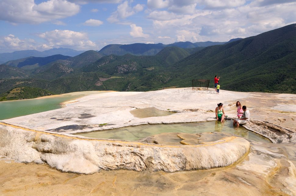 """<a href=""""http://www.lonelyplanet.com/mexico/hierve-el-agua/introduction"""" target=""""_blank"""">Both locals and visitors flock</a> t"""