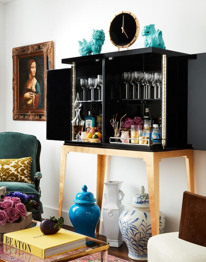 <p>A large bar cabinet makes a statement in a small space while providing ample (and attractive) storage.</p>
