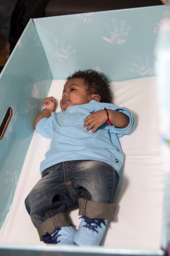 The universal baby box program aims to prevent infant deaths due to unsafe sleeping environments.