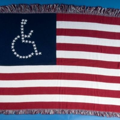 <strong>An American Flag blanket sewn by disability rights activists from the ADAPT group. The normal fifty stars are placed