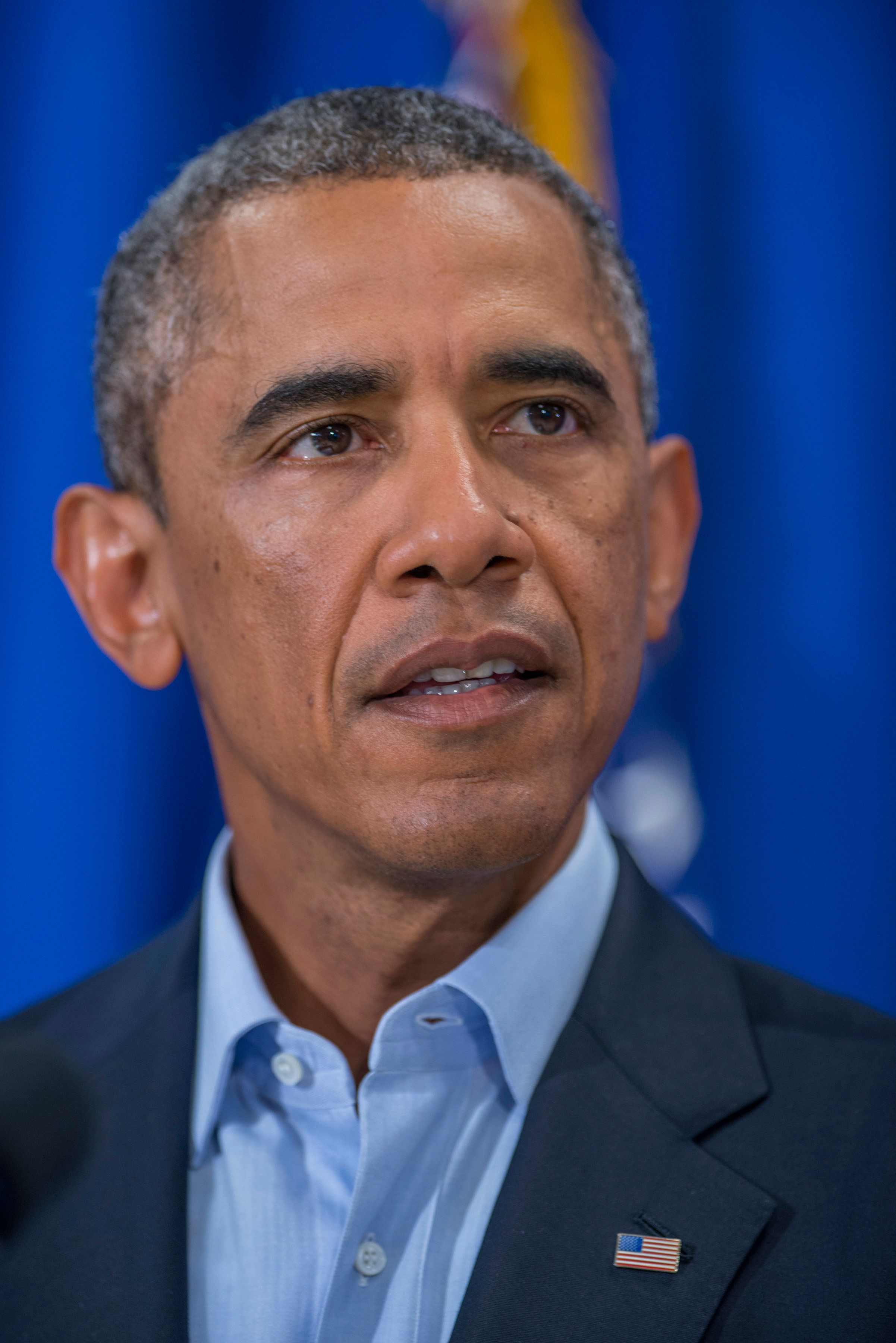 President Barack Obama speaking about the murder of journalist James Foley during a press briefing at the press filing center at the Edgartown School in Edgartown, Martha's Vineyard, MA on August 20, 2014.   (Photo by Rick Friedman/WHITE HOUSE POOL (ISP POOL IMAGES)/Corbis/VCG via Getty Images)