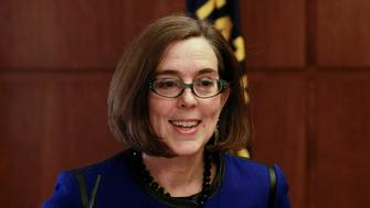 Oregon Governor Kate Brown speaks at the state capital building in Salem, Oregon February 20, 2015. Brown, a liberal Democrat from Portland, outlined her policy agenda on Friday in her first media event since she took the helm of the Pacific Northwest state to replace John Kitzhaber, whose decades-long political career dissolved in the wake of an influence-peddling scandal involving his fiancee.  REUTERS/Steve Dipaola (UNITED STATES - Tags: POLITICS HEADSHOT)