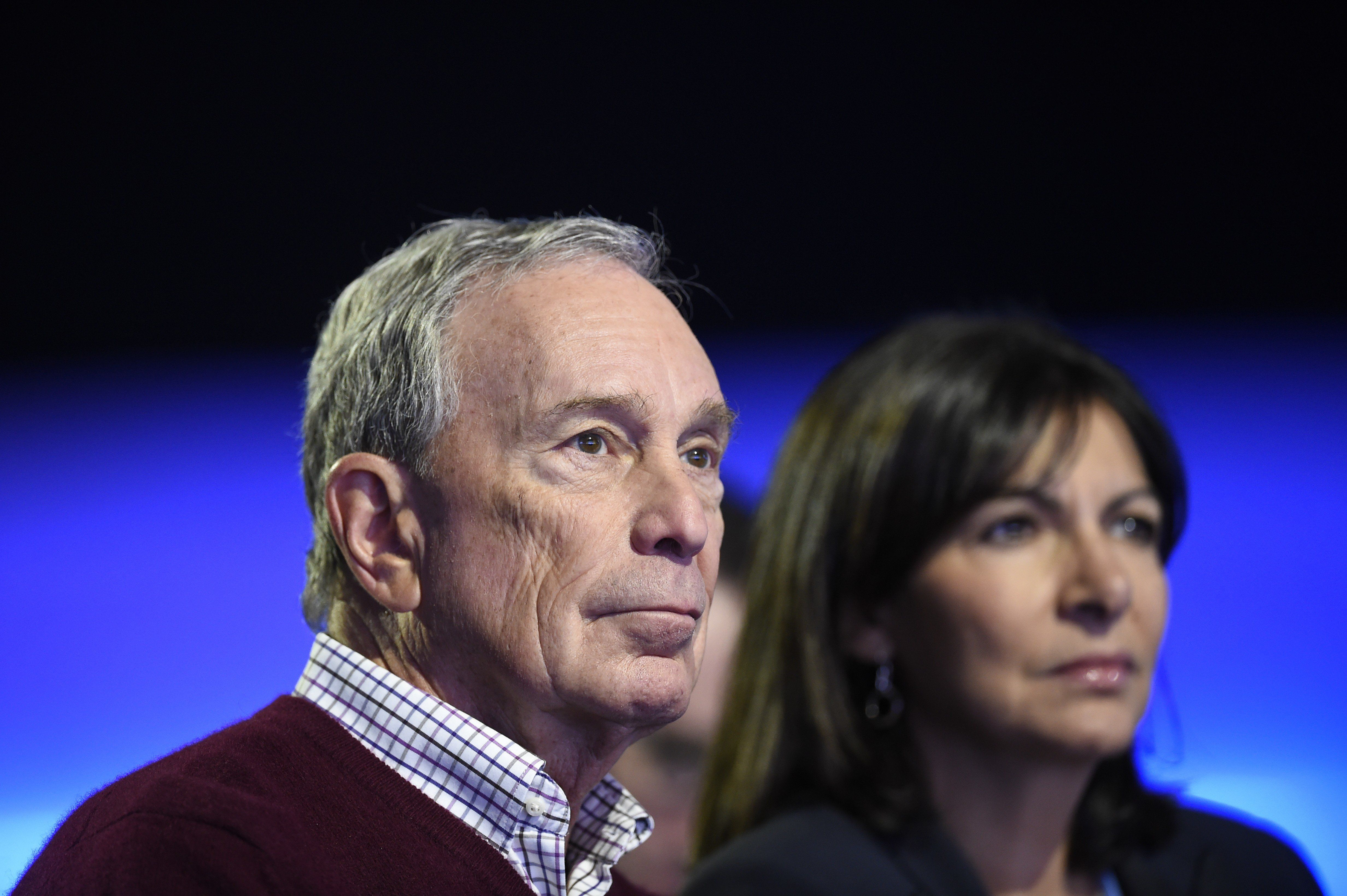 Former mayor of New York Michael Bloomberg (L) and Mayor of Paris Anne Hidalgo attend a working session for 'Action Day' at the COP21 United Nations conference on climate change in Le Bourget on December 5, 2015. AFP PHOTO / ERIC FEFERBERG / AFP / ERIC FEFERBERG        (Photo credit should read ERIC FEFERBERG/AFP/Getty Images)