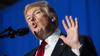 US President Donald Trump speaks to the staff at the Department of Homeland Security in Washington, DC, on January 25, 2017. Trump vowed to restore 'control' of US frontiers as he moved Wednesday to fulfil his pledge to 'build a wall' on the Mexican border, signing two immigration-related decrees and sounding a hardline tone. / AFP / NICHOLAS KAMM        (Photo credit should read NICHOLAS KAMM/AFP/Getty Images)