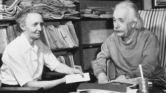 (Original Caption) 3/20/1948- Princeton, NJ: Madame Joliot-Curis guest of Einstein. Albert Einstein (right) and Madame Irene Joliot Curie, French nuclear physicist, talk informally in the study of Einstein's home in Princeton, N.J. Madame Joliot-Curie, who was detained overnight at Ellis Ilsand when she arrives in the US March 18th, was Professor Einstein's guest.