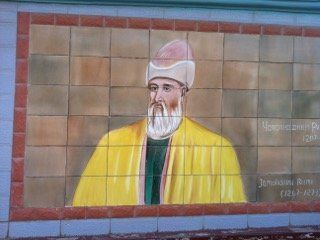An image of Rumi taken by Brad Gooch appears on a wall leading into Dushanbe, in Tajikistan.