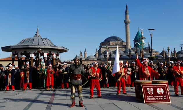 Turkish soldiers, members of the historical Ottoman military band of Mehter, perform outside the Mevlana...
