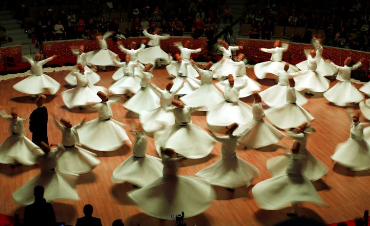 "Whirling dervishes perform a traditional ""Sema"" ritual during a ceremony, one of many marking the 743rd anniversary of the de"